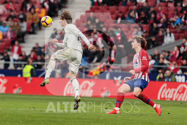 Atletico de Madrid's Antoine Griezmann and Real Madrid's Luka Modric during La Liga match between Atletico de Madrid and Real Madrid at Wanda Metropolitano Stadium in Madrid, Spain. February 09, 2019. (ALTERPHOTOS/A. Perez Meca)