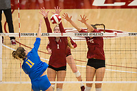 STANFORD, CA - NOVEMBER 17: Stanford, CA - November 17, 2019: Jenna Gray, Madeleine Gates at Maples Pavilion. #4 Stanford Cardinal defeated UCLA in straight sets in a match honoring neurodiversity. during a game between UCLA and Stanford Volleyball W at Maples Pavilion on November 17, 2019 in Stanford, California.