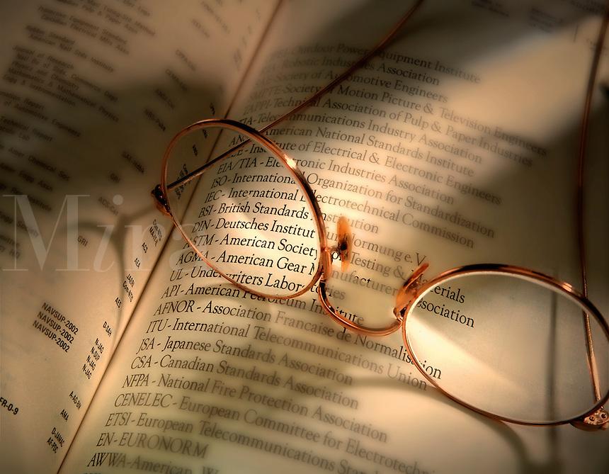 eye glasses on technical manual. .