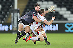 Ulster centre Darren Cave looks for support as he's tackled by Ospreys hooker Scott Baldwin.<br /> Guiness Pro12<br /> Ospreys v Ulster<br /> 20.12.14<br /> ©Steve Pope -SPORTINGWALES