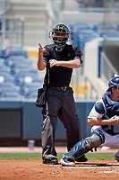 Umpire Brandon Blome calls a strike during a Florida State League game between the Dunedin Blue Jays and Charlotte Stone Crabs on April 17, 2019 at Charlotte Sports Park in Port Charlotte, Florida.  Charlotte defeated Dunedin 4-3.  (Mike Janes/Four Seam Images)