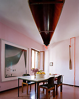 Echoing the canal at sunset, a pink-hued kitchen provides a tranquil space for breakfast within the Venetian apartment of Lars Rachen