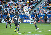 CARSON, CA - SEPTEMBER 29: Zlatan Ibrahimovic #9 of the Los Angeles Galaxy leaps high for a head ball during a game between Vancouver Whitecaps and Los Angeles Galaxy at Dignity Health Sports Park on September 29, 2019 in Carson, California.