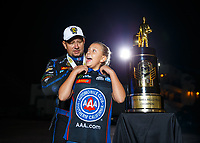 Nov 12, 2017; Pomona, CA, USA; NHRA funny car driver Robert Hight poses for a portrait with daughter Autumn Hight and the trophy after clinching the 2017 world championship during the Auto Club Finals at Auto Club Raceway at Pomona. Mandatory Credit: Mark J. Rebilas-USA TODAY Sports