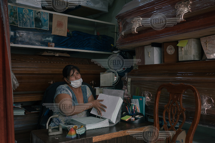 Guadalupe Marquez (48) arranges paperwork at her funeral home opposite a public hospital in Iztapalapa.