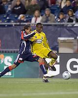 Columbus Crew midfielder Emmanuel Ekpo (17) prepares to cross as New England Revolution defender Kevin Alston (30) defends. The Columbus Crew defeated the New England Revolution, 1-0, at Gillette Stadium on October 10, 2009.