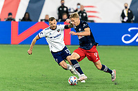 FOXBOROUGH, MA - APRIL 24: Adam Buksa #9 of New England Revolution on the attack as Frederic Brillant #13 of D.C. United defends during a game between D.C. United and New England Revolution at Gillette Stadium on April 24, 2021 in Foxborough, Massachusetts.