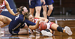 SIOUX FALLS, SD - MARCH 6: Faith Paramore #22 of the Oral Roberts Golden Eagles battles for the loose ball with Maddie Krull #42 of the South Dakota Coyotes during the Summit League Basketball Tournament at the Sanford Pentagon in Sioux Falls, SD. (Photo by Richard Carlson/Inertia)