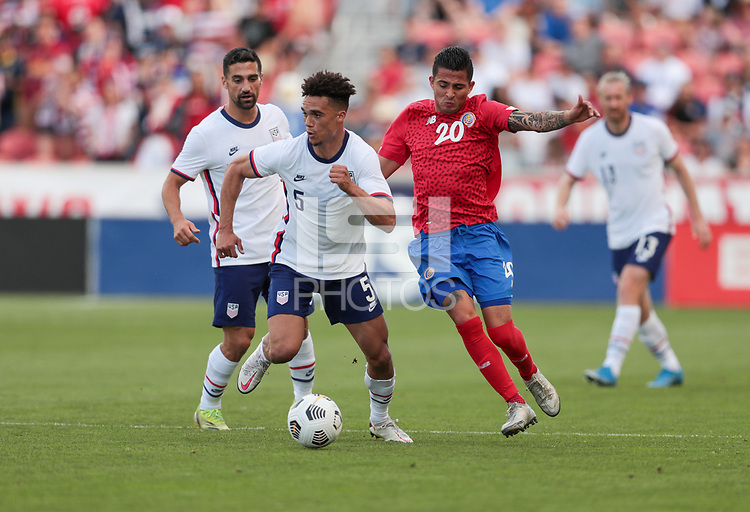 SANDY, UT - JUNE 10: Antonee Robinson #5 of the United States looks for an open man downfield during a game between Costa Rica and USMNT at Rio Tinto Stadium on June 10, 2021 in Sandy, Utah.