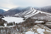 Cannon Mountain, Echo Lake, and Franconia Notch from Artists Bluff in the White Mountains, New Hampshire on a cloudy winter day.