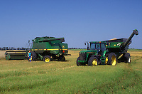 AJ0470, North Dakota, harvest, Farm machinery harvesting a field of wheat in Richland County.
