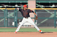 AZL Giants Orange shortstop Francisco Medina (19) throws to first base during an Arizona League game against the AZL Rangers at Scottsdale Stadium on August 4, 2018 in Scottsdale, Arizona. The AZL Giants Black defeated the AZL Rangers by a score of 3-2 in the first game of a doubleheader. (Zachary Lucy/Four Seam Images)
