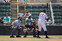 Casey Schroeder (17) of the Kannapolis Intimidators at bat as West Virginia Power catcher Arden Pabst (25) sets a target and home plate umpire Zach Neff looks on at Kannapolis Intimidators Stadium on June 18, 2017 in Kannapolis, North Carolina.  The Intimidators defeated the Power 5-3 to win the South Atlantic League Northern Division first half title.  It is the first trip to the playoffs for the Intimidators since 2009.  (Brian Westerholt/Four Seam Images)