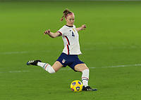 ORLANDO CITY, FL - FEBRUARY 18: Becky Sauerbrunn #4 passes the ball during a game between Canada and USWNT at Exploria stadium on February 18, 2021 in Orlando City, Florida.