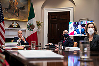 United States President Joe Biden participates in a virtual bilateral meeting with President Andrés Manuel López Obrador of Mexico in the Roosevelt Room of the White House in Washington on March 1st, 2021. United States Secretary of Homeland Security Alejandro Mayorkas is at center and Elizabeth Sherwood-Randall, Deputy National Security Advisor for Homeland Security is at right.<br /> Credit: Anna Moneymaker / Pool via CNP /MediaPunch