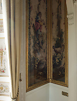 An original neo-classical mural is protected beneath gilt-framed glass panelling