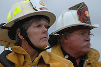 Monday December 8, 2008:  University City, San Diego California.  Fire Chief Tracy Jarman listens as Mayor Jerry Sanders address the media at the scence where a military jet crashed into a residential home killing at least 2 civilians.  At approximately 11:59am a USMC F-18 fighter jet encountered trouble over this residential area of the city and the pilot ejected leaving his aircraft to crash into a residential neighborhood.