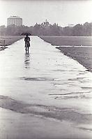 Man walking down path in the rain<br />