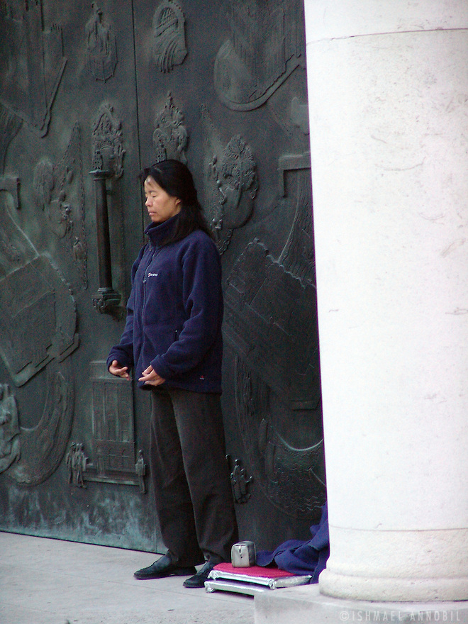 For a very long time, Falun Gong followers like this lady have been holding a round the clock vigil outside the Royal Institute of British Architects, opposite the Chinese Embassy in Portland Pl, Marylebone, London. The distance between the two instutions is safe but tense, maintained ably by the Metropolitan police.