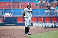 Fayetteville Woodpeckers manager Ray Hernandez (12) coaches third base during the game against the Kannapolis Cannon Ballers at Atrium Health Ballpark on June 22, 2021 in Kannapolis, North Carolina. (Brian Westerholt/Four Seam Images)
