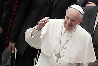 Papa Francesco saluta i fedeli al suo arrivo all'udienza ai partecipanti al Giubileo delle Persone socialmente escluse, in aula Paolo VI, Citta' del Vaticano, 11 novembre 2016.<br /> Pope Francis waves to faithful as he arrives to lead a Jubilee audience with people socially excluded in Paul VI hall at the Vatican 11 November, 2016.<br /> UPDATE IMAGES PRESS/Isabella Bonotto<br /> <br /> STRICTLY ONLY FOR EDITORIAL USE