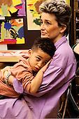 MR / Schenectady, NY.Yates Arts Magnet School / Pre-K.Boy (4, African-American) rests on teacher..MR: Fel2 / Mar7.PN#: 26891                       FC#: 27379-00713.scan from slide.©Ellen B. Senisi