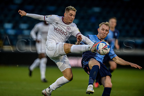 21st November 2020; Adams Park Stadium, Wycombe, Buckinghamshire, England; English Football League Championship Football, Wycombe Wanderers versus Brentford; Sergi Canos competes with Wycombe's Jack Grimmer
