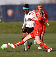 Nikki Marshall of the Washington Freedom tackles the ball away from Danesha Adams of the Philadelphia Independence during their preseason game at the Maryland SoccerPlex in Germantown, Maryland.