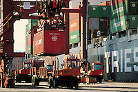 containers being offloaded freighters at Casco Terminals. Transportation, industry, crane, ship, freighter, harbor, trade, truck, vehicle, port. Vancouver British Columbia Canada inner harbour.