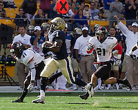 Pitt running back Ray Graham scores on a 78-yard run as Tiko Thompson (41) and Gianni Olivas (21) pursue in vain. The Pitt Panthers defeated the Gardner-Webb Runnin Bulldogs 55-10 at Heinz Field, Pittsburgh PA on September 22, 2012..