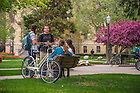 May 4, 2015; Students chat on a bench on Main Quad. (Photo by Matt Cashore/University of Notre Dame)