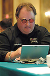 Greg Raymer competes in the Battleship Poker Tournament.