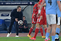Hans-Dieter Flick coach of Bayern Munchen holds the ball during the Champions League round of 16 football match between SS Lazio and Bayern Munchen at stadio Olimpico in Rome (Italy), February, 23th, 2021. Photo Andrea Staccioli / Insidefoto
