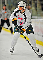 28 January 2012: University of Vermont Catamount forward Kyle Reynolds, a Freshman from Sylvan Lake, Alberta, sets up a play against the Northeastern University Huskies at Gutterson Fieldhouse in Burlington, Vermont. The Catamounts, dressed in their Breast Cancer Awareness jerseys, fell to the Huskies 4-2 in the second game of their 2-game Hockey East weekend series. Mandatory Credit: Ed Wolfstein Photo