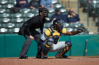 West Virginia Mountaineers catcher Paul McIntosh (34) frames a pitch as home plate umpire Anthony Perez looks on during the game against the Illinois Fighting Illini at TicketReturn.com Field at Pelicans Ballpark on February 23, 2020 in Myrtle Beach, South Carolina. The Fighting Illini defeated the Mountaineers 2-1.  (Brian Westerholt/Four Seam Images)