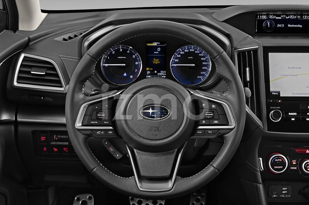 Car pictures of steering wheel view of a 2021 Subaru Impreza Premium 5 Door Hatchback Steering Wheel