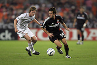 30 October,  2004.   DC United's Ben Olsen (14) brings the ball up the field during the 2004 MLS playoffs at RFK Stadium in Washington, DC.