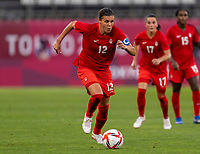 KASHIMA, JAPAN - AUGUST 2: Christine Sinclair #12 of Canada dribbles during a game between Canada and USWNT at Kashima Soccer Stadium on August 2, 2021 in Kashima, Japan.