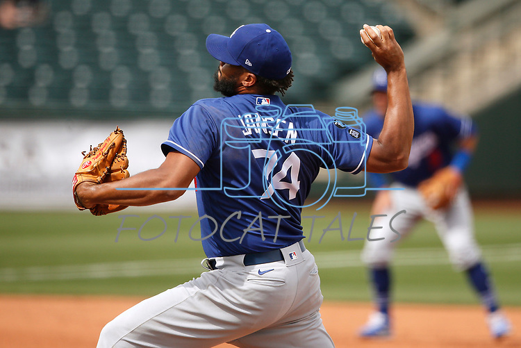 Kenley Jansen pitches during a spring training game between the Texas Rangers and Los Angeles Dodgers in Surprise, Ariz., on Sunday, March 7, 2021.<br /> Photo by Cathleen Allison