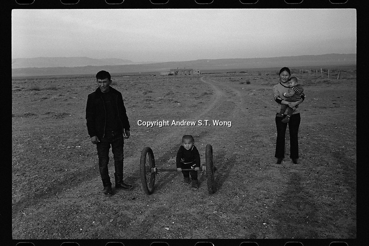 Jeminay County, Xinjiang Uygur Autonomous Region, China - A herder's family seen on a steppe, October 2019.