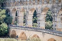 breakaway group over the ancient/famous aquaduct 'Pont du Gare'<br /> <br /> Stage 16: Nîmes to Nîmes(177km)<br /> 106th Tour de France 2019 (2.UWT)<br /> <br /> ©kramon