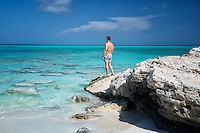 Visitor viewing ocean at Half Moon Bay. Turks and Caicos. Providenciales.