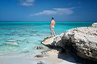 Visitor viewing ocean at Half Moon Bay. Turks and Caicos. Providenciales.