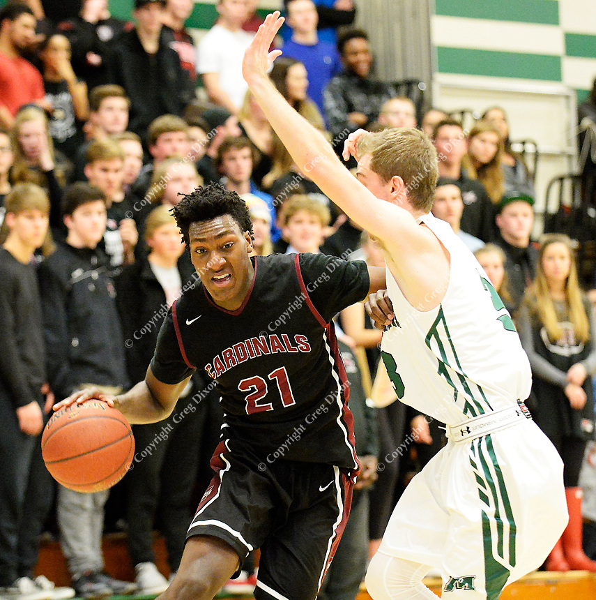 Middleton's Tyree Eady works past Memorial's Billy Wilson during the second half of the Big Eight Conference boys basketball game between Middleton and Madison Memorial on Thursday at Memorial High School in Madison