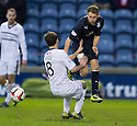 Raith Rovers' Kevin Moon challenges Dundee's Gary Irvine.