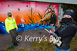 Artist Ciara McKenna standing at her newly created mural on the Tralee Greenway on Monday. Front right: Ciara McKenna. Back l to r: Anne Marie Fuller and Anluan Dunne (Chairman Kerry Green Party)