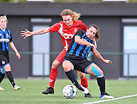 Sylke Calleeuw (9) of Standard  pictured fighting for the ball with Jody Vangheluwe (22) of Club Brugge during a female soccer game between Club Brugge Dames YLA and Standard Femine de Liege on the seventh matchday in Play-Off 1 of the 2020 - 2021 season of Belgian Scooore Womens Super League , saturday 15 May 2021  in Brugge , Belgium . PHOTO SPORTPIX.BE | SPP | DAVID CATRY