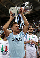 Calcio, Football - Juventus vs Lazio Italian Super Cup Final  <br /> Lazio's Stefan Radu celebrates with the trophy after winning the Italian Cup Final match at Rome's Olympic stadium, on August 13, 2017.<br /> UPDATE IMAGES PRESS/Isabella Bonotto