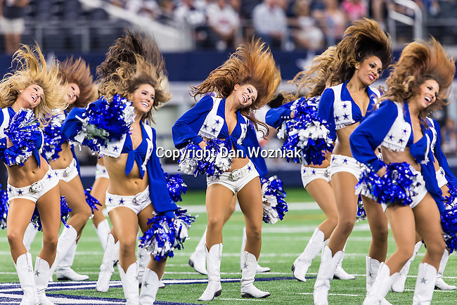 Dallas Cowboys cheerleaders in action during the pre-season game between the Houston Texans and the Dallas Cowboys at the AT & T stadium in Arlington, Texas.