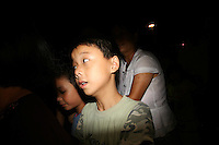 CHINA. Beijing. Spectators in the Olympic village whilst watching rehearsals for the Beijing Olympic games. 2008